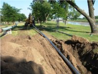 HDD pipes pulled into drill hole. Directional drilling services, Oklahoma.