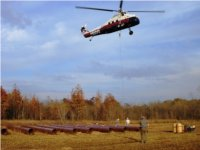 HDD site delivery of pipes using helicopter. Directional drilling services, Oklahoma.